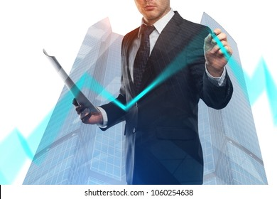 Businessman drawing business chart line on abstract city background. Finance and growth concept. Double exposure