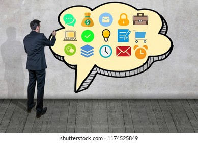 Businessman drawing business concept on a wall