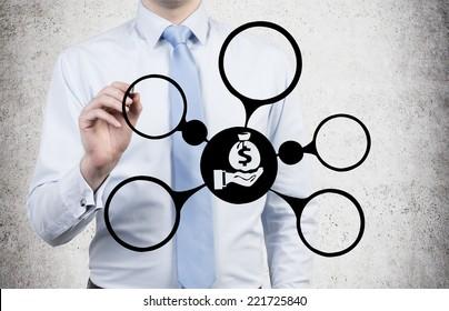 Businessman drawing business optimization scheme.