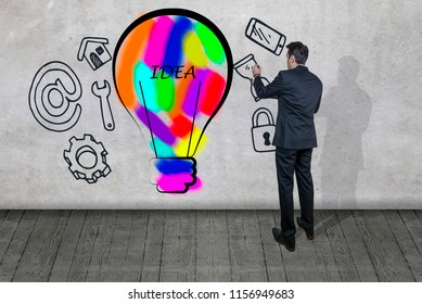 Businessman drawing a business plan on a wall