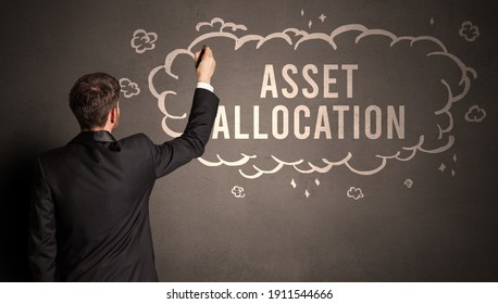 businessman drawing a cloud with ASSET ALLOCATION inscription inside, modern business concept