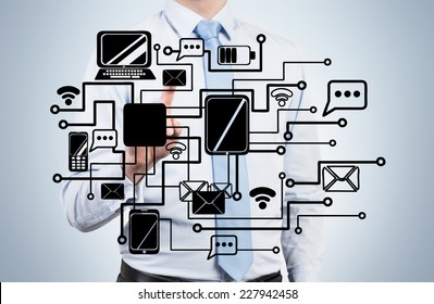 Businessman is drawing a corporate internal network.