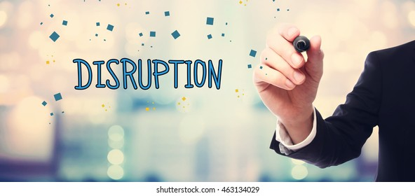 Businessman drawing Disruption concept on blurred abstract background