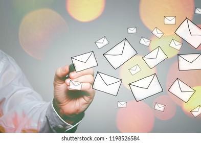 Businessman drawing E-mails concept