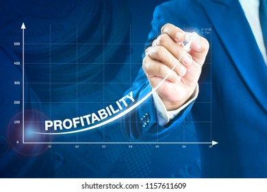Businessman drawing an exponential curve of a progress in business performance and profitability, on a virtual screen presentation.