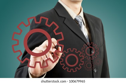 Businessman drawing gear to success