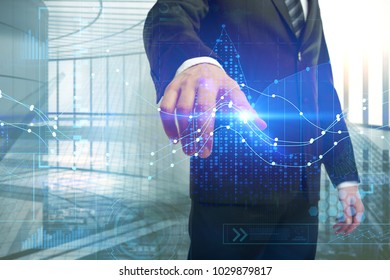 Businessman drawing glowing forex chart on abstract office interior background. Future and technology concept. Double exposure