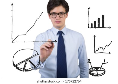 Businessman drawing graph, bar chart and a pie chart