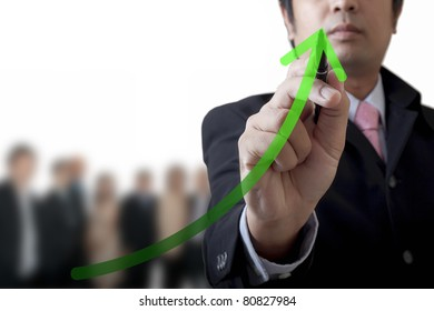 Businessman drawing a graph on the board