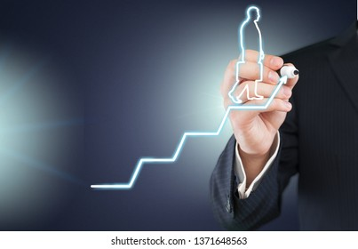 Businessman drawing graphics on background