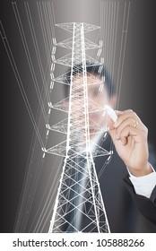 Businessman Drawing High voltage power pole line.