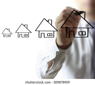 Businessman drawing a house