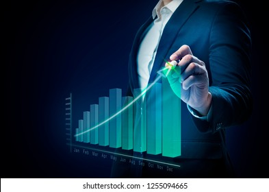 Businessman drawing a increases graph on virtual screen. Business concept