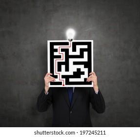 Businessman drawing a labyrinth