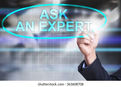 "Businessman drawing on virtual screen text ""Ask an expert"". Business concept. Internet concept."