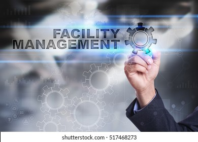 Businessman is drawing on virtual screen. facility management concept