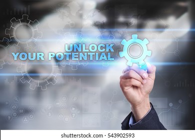 Businessman is drawing on virtual screen. unlock your potential concept.