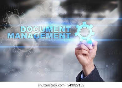 Businessman is drawing on virtual screen. document management concept.