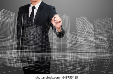 businessman drawing perspective wire frame building