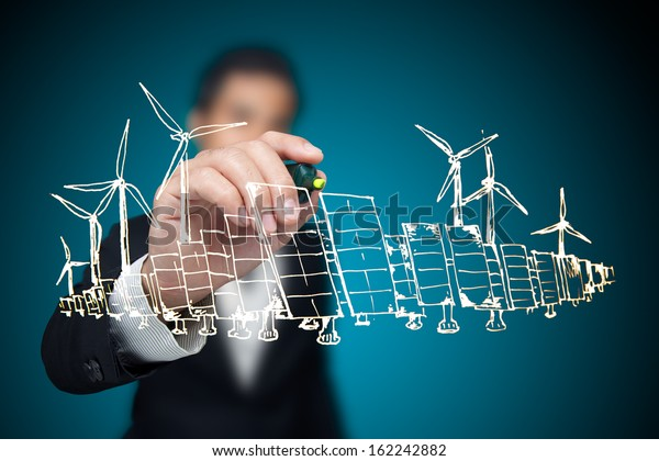 Empresario dibujando proyecto de energía renovable.