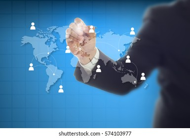 Businessman drawing a world map and networking communication online , business network concept