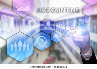 """Businessman draws """"Accounting"""" on the virtual screen. Business concept. Internet concept."""