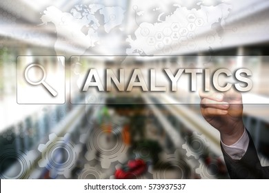 "Businessman draws ""Analytics"" on the virtual screen. Touch Screen. Virtual Icon. Graphs Interface. Business concept. Internet concept. Digital Interfaces"