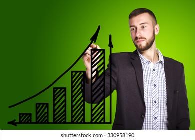 Businessman draws a graph