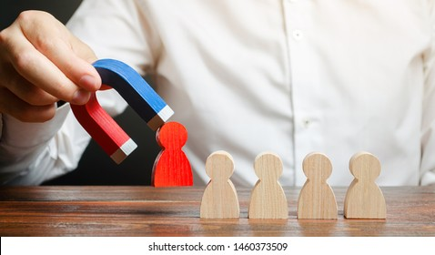 The businessman draws a red figure from the team with a magnet. leader manages the business and forms a team. The concept of toxic and non-competent worker. Increase team efficiency and productivity.