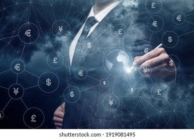 Businessman draws the structure of the global system of currency transactions on the background of space.