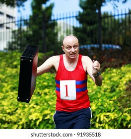 A businessman dressed in running attire with the number one on his chest, carrying a briefcase in a beautiful park and obviously running late.