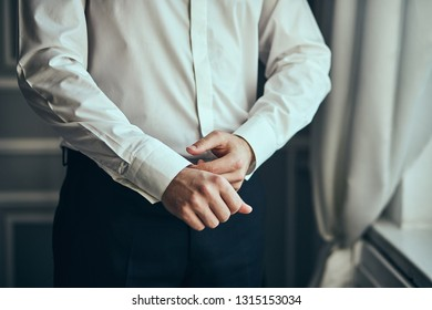 businessman dresses white shirt, male hands closeup,groom getting ready in the morning before wedding ceremony. Men Fashion