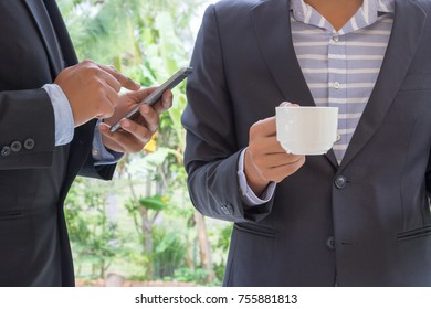 businessman drink coffee and serching information from internet