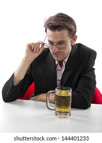 Businessman drinking beer on a white countertop and looking at copyspace