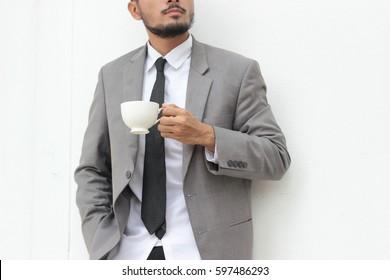 businessman drinking coffee on white background
