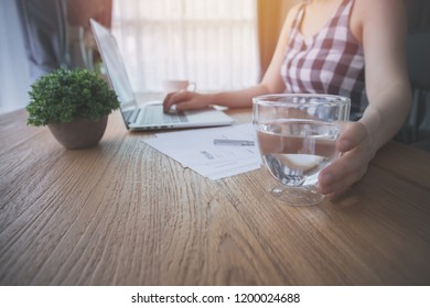 businessman drinking water and searching online for job, concept of heathy care lifestyle.