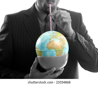 Businessman drinking the world, a power leader metaphor