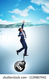 Businessman drowning under the burden of sin and guilt