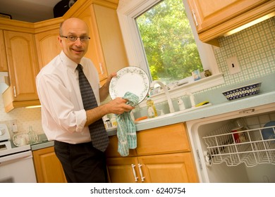 Businessman drying dishes