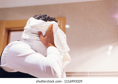Businessman drying his head with a towel
