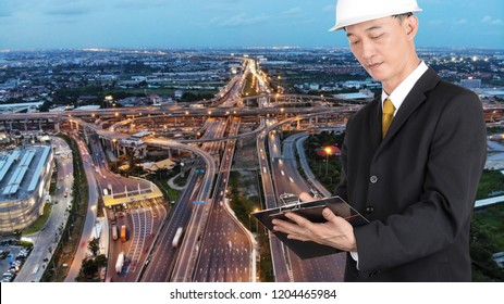 Businessman with duoble exposure road background.