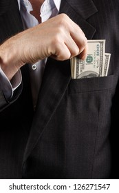 businessman with earned money in suit pocket