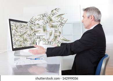 Businessman Earning Lots Of Cash In Internet