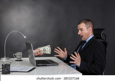 Businessman earning money on network.  He is receiving dolar cash over internet.