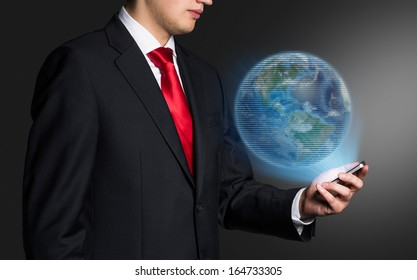 Businessman and earth.  Elements of this image furnished by NASA.