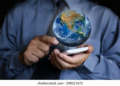 businessman with the earth, Elements of this image are furnished by NASA