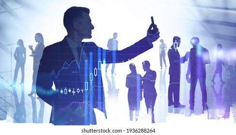 Businessman with electronic device, skyscrapers with silhouettes of corporate team, candlesticks and graph lines. Concept of international communication and company