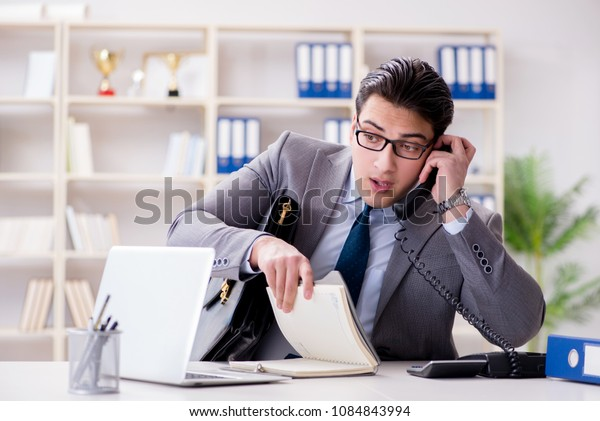 Businessman employee talking on the office phone
