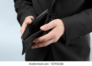 Businessman with empty purse, closeup