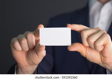 Businessman with empty showcase, buisness card